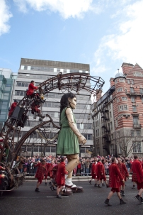 Giant marionette walks the street