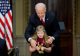 Vice President Joe Biden helps Kayla Kosmalski of Bear, Del. during a celebration of the ABLE Act (Achieving a Better Life Experience Act), with members of Congress, Tuesday, Feb. 10, 2015, in the Eisenhower Executive Office Building on the White House complex in Washington. The Act creates a new savings account for families with people with disabilities. These tax-preferred accounts allow families to save for future disability-related expenses without losing Medicaid and Social Security benefits. (AP Photo/Manuel Balce Ceneta)